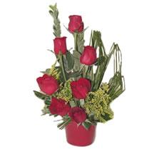 Amasya çiçekçi mağazası  minik vazoda 7 adet kirmizi gül